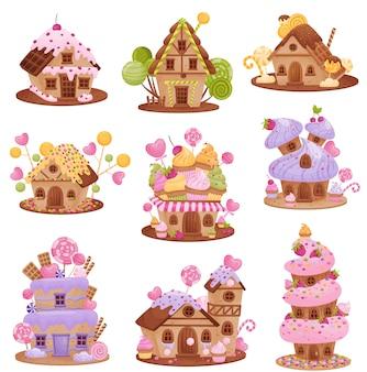 Conjunto de diferentes casas de pan de jengibre. decorado con gofres, nata, glaseado, grageas de colores, fresas, cerezas y pastelitos.