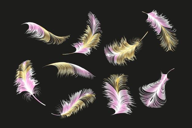 Conjunto de diferentes plumas torcidas esponjosas caídas sobre un fondo blanco.