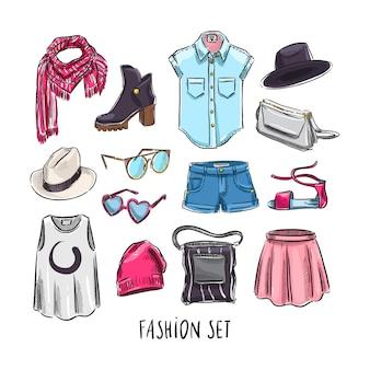 Conjunto de diferentes prendas y accesorios femeninos.