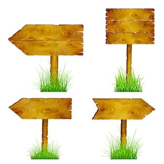 Conjunto de direcciones de punteros de madera en blanco en pasto verde
