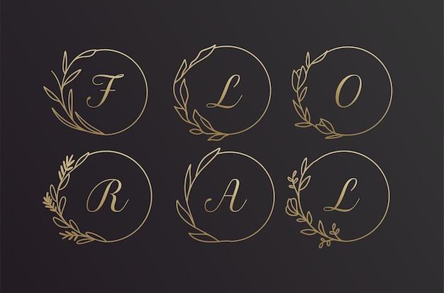 Conjunto de diseño de marco de logotipo de corona de flores de alfabeto dibujado a mano negro y dorado floral