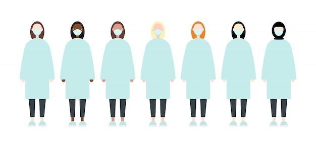 Conjunto de diversas mujeres de raza con máscaras. la enfermera friega la ropa. estilo plano