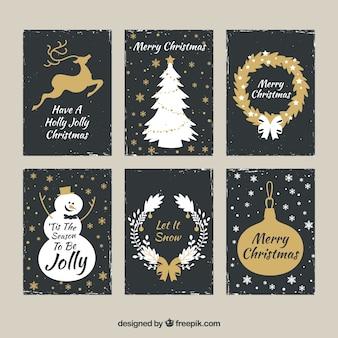 Conjunto dorado de tarjetas de navidad