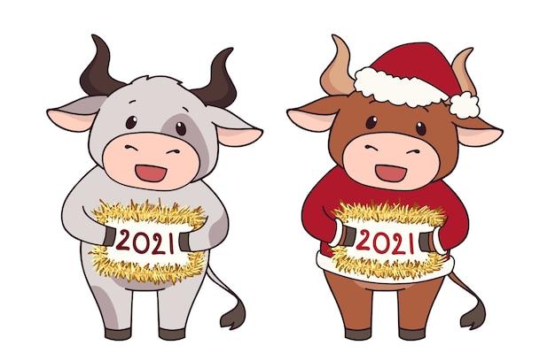 Conjunto de dos vacas de dibujos animados con traje de navidad.