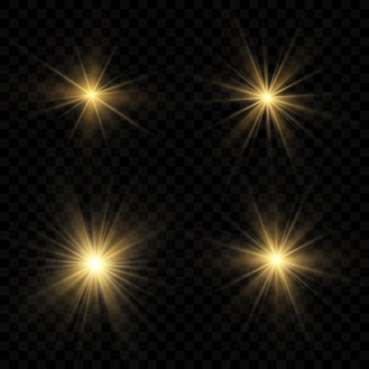 Conjunto de efectos de luz dorada sobre un fondo transparente