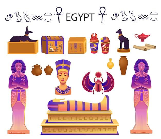 Conjunto egipcio con sarcófago, cofres, estatuas del faraón con el ankh, una figura de gato, perro, nefertiti, columnas, escarabajo y lámpara.