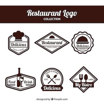 Conjunto elegante de logos de restaurante con diseño de insignia