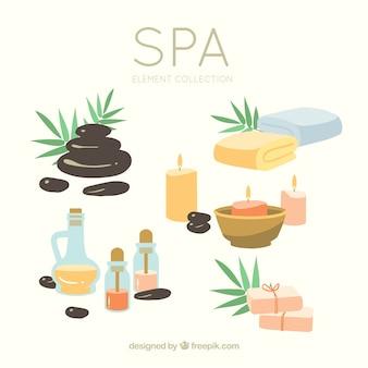 Conjunto de elementos de centro de spa con velas y aceites aromáticos