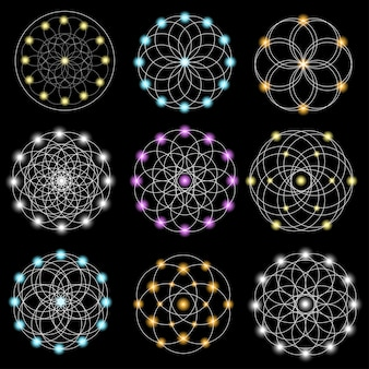 Conjunto de elementos geométricos abstractos y formas sobre fondo negro.