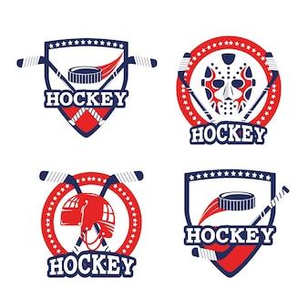 Conjunto emblema con palos y equipo de puck.