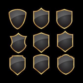 Conjunto de escudo de oro negro.