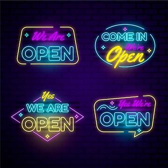 Conjunto de estamos abiertos en luces de neón