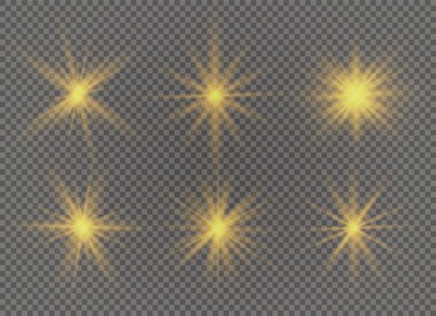 Conjunto de estrella brillante. la luz amarilla brillante explota sobre un fondo transparente. sol brillante transparente, destello brillante. para centrar un flash brillante. partículas de polvo mágico espumoso. destellos.
