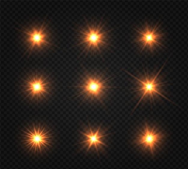 Conjunto de estrella brillante. la luz dorada brillante explota sobre un fondo transparente.