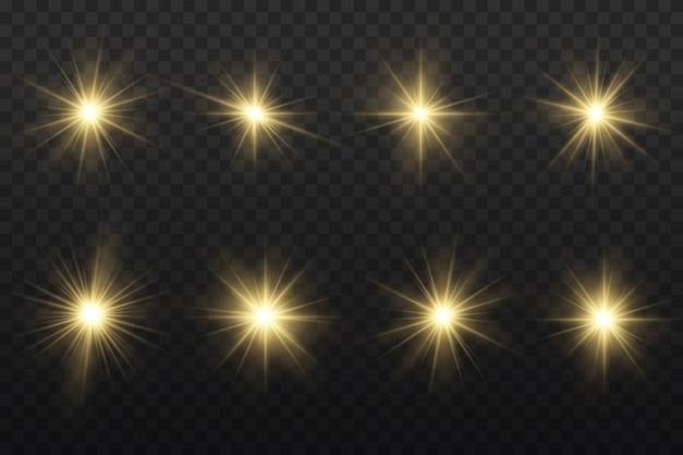 Conjunto de estrella estalló con brillo, estrella brillante resplandor, luz brillante amarilla estalló sobre un fondo transparente, rayos de sol amarillo, efecto de luz dorada, destello de sol con rayos.