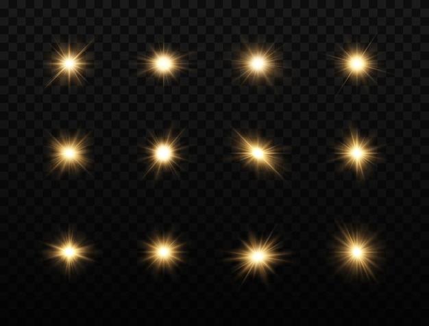 Conjunto de estrellas brillantes la luz brillante dorada explota sobre un fondo transparente