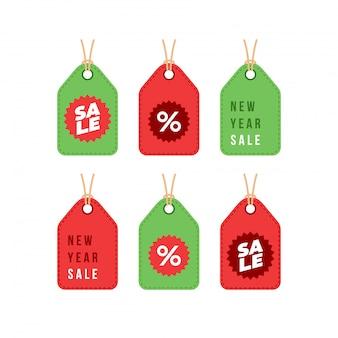Conjunto de etiquetas de compras de descuento de venta de invierno de año nuevo y feliz navidad
