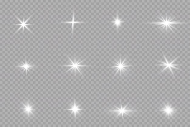 Conjunto de flashes, luces y destellos. brillantes destellos dorados y resplandores. resumen luces doradas aisladas brillantes rayos de luz. líneas brillantes