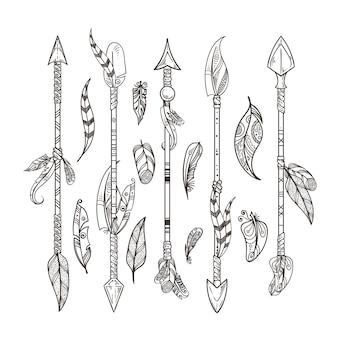 Conjunto de flechas y plumas decorativas.