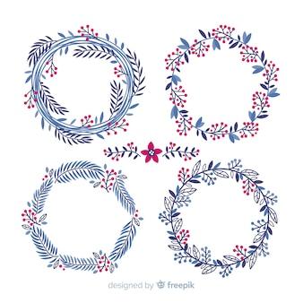 Conjunto de flores y guirnaldas navideñas dibujadas a mano