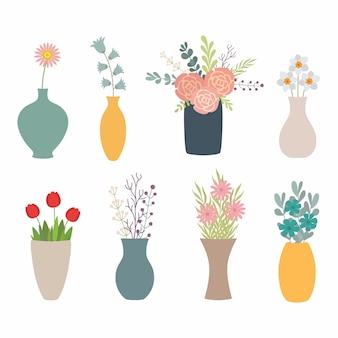 Conjunto de flores en jarrones en blanco