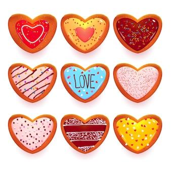 Conjunto de galletas de jengibre en forma de dulces de dibujos animados de corazón para el día de san valentín aislado en blanco.