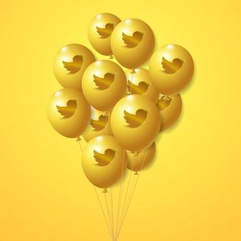 Conjunto de globos dorados con el logo de twitter