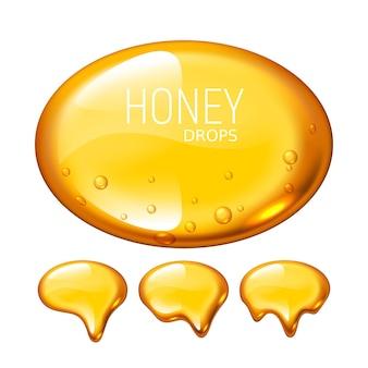 Conjunto de gotas de miel sobre fondo blanco.