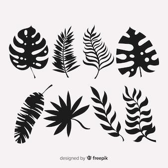 Conjunto de hojas tropicales con estilo de silueta