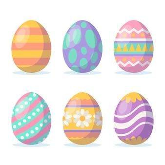 Conjunto de huevos de pascua con diseño plano de diferentes texturas