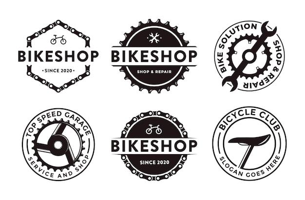 Conjunto de icono de logotipo de club de bicicletas de tienda de bicicletas emblema insignia con manivela de engranaje y concepto de herramienta mecánica