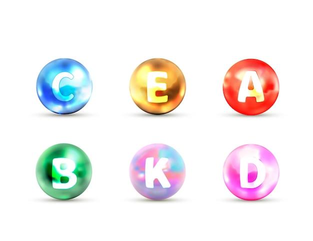 Conjunto de iconos brillantes brillantes de vitaminas abcde, k aislado en blanco