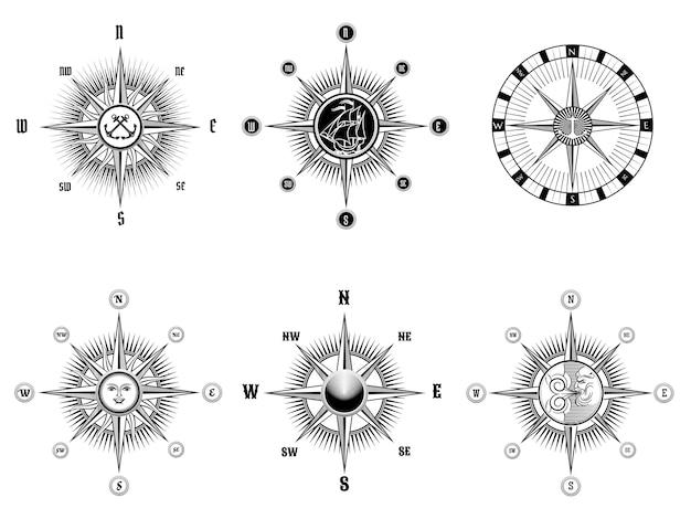 Conjunto de iconos de brújula náutica o marina vintage dibujados líneas negras sobre un fondo blanco.