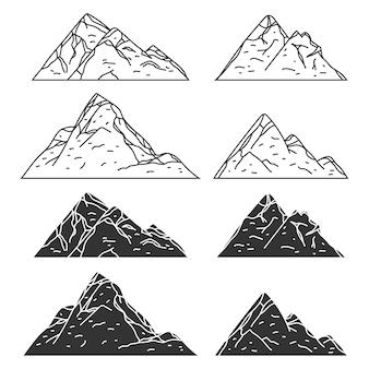 Conjunto de iconos negros de montañas aislado en un fondo blanco.