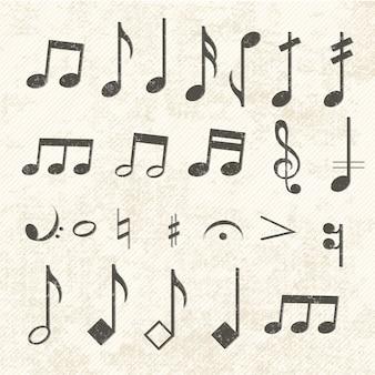 Conjunto de iconos de notas musicales vintage desgastado por el tiempo