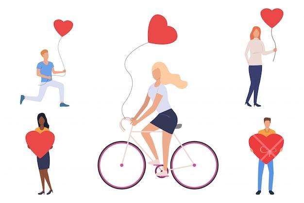 Conjunto de jóvenes con globos de corazón.