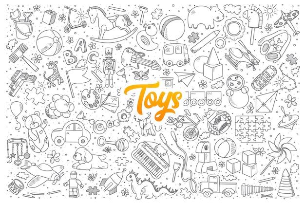 Conjunto de juguetes dibujados a mano garabatos con letras amarillas