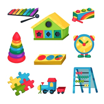 Conjunto de juguetes para niños. xilófono, pirámide con anillos, ábaco, rompecabezas, reloj, tren, casa con agujeros para figuras geométricas. elementos planos