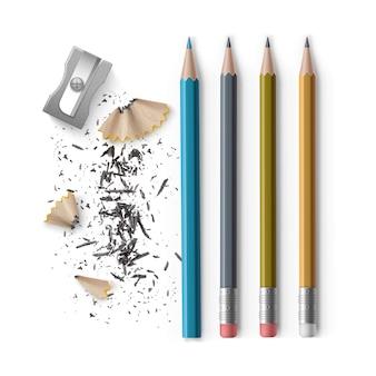 Conjunto de lápices de grafito y de colores afilados con goma y sacapuntas con virutas aislado sobre fondo blanco.