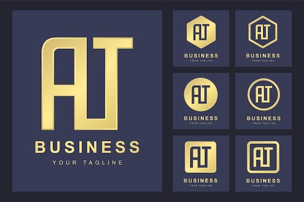 Conjunto de letra inicial abstracta at, plantilla de logotipo dorado. logo.