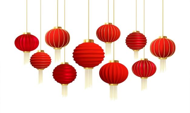 Conjunto de linternas de año nuevo chino de oro rojo realistas aisladas sobre fondo blanco.