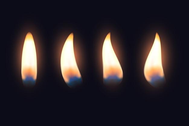 Conjunto de llamas de velas en la oscuridad