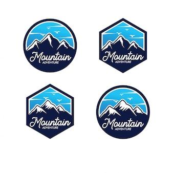 Conjunto de logotipo de aventura de montaña