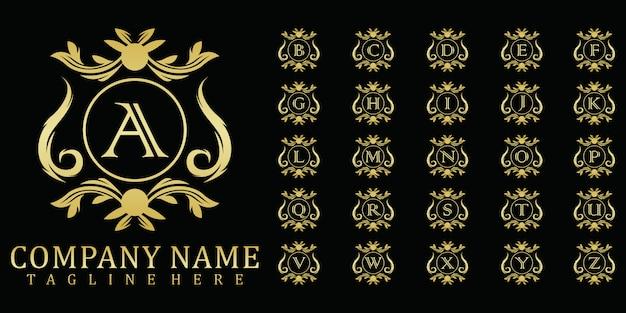Conjunto de logotipo de insignia inicial de lujo