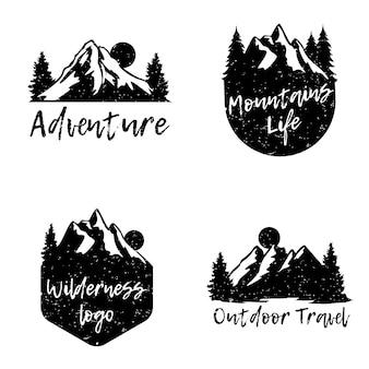 Conjunto de logotipo de insignia de montaña de aventura