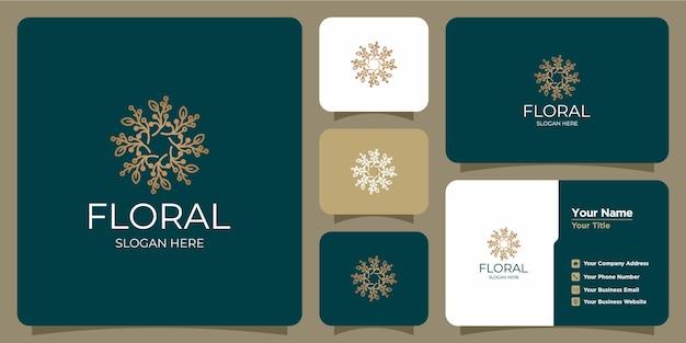 Conjunto de logotipos y tarjetas de visita de plantillas florales femeninas y modernas dibujadas a mano