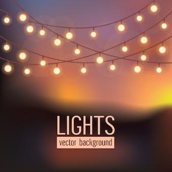 Conjunto de luces de cadena brillantes sobre fondo de cielo abstracto de noche