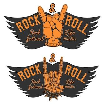 Conjunto de las manos humanas con signo de rock and roll y alas. festival de rock and roll. elementos de diseño para cartel, emblema.
