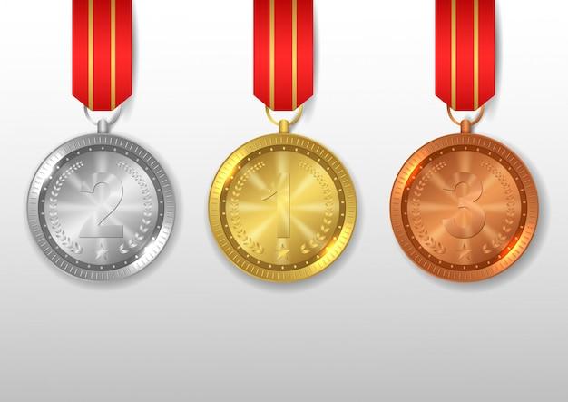 Conjunto de medallas de oro, plata y bronce.