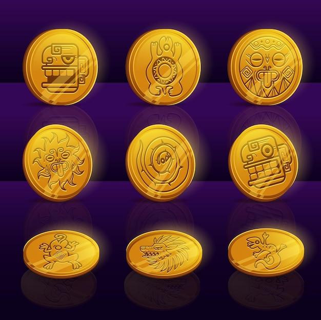 Conjunto de monedas de oro con mayas o aztecas.